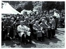 Group of men seated, front row of 3 in armchairs /...