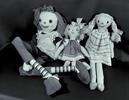 Three handmade cloth dolls.