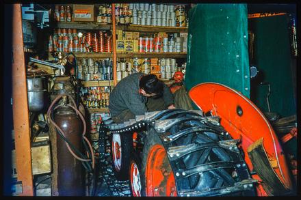 [Mechanic working on snow tractor]