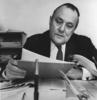 Robert Muldoon at a desk reading.
