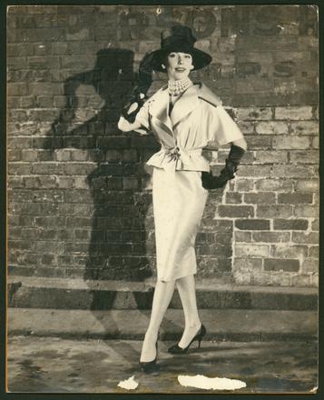 [Model posing in silk suit designed by Emma Knuckey]