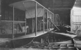 Interior of shed with two biplanes.