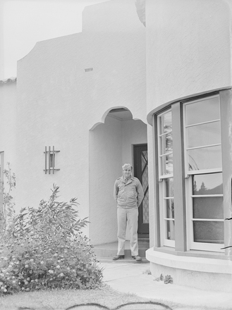 [Portrait of US military serviceman standing at the entranceway of Tudor Collins'…