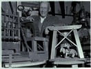 Mr J. Smith stands behind his wooden model of a go...