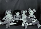 Four handmade cloth dolls.