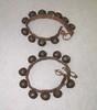bells- worn by dancers on legs; threaded on leathe...