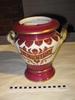 lidded ceramic urn, labelled 'LEECHES' description...