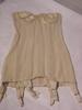 woman's strapless corset in cream coloured decorat...