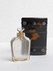 perfume bottle made of clear cut glass with stoppe...