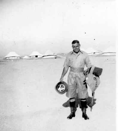 Portrait, WW2, Major Carson in the desert, holding his issue of tropical kit, was taken at Maadi Camp, Cairo in late 1940. (supplied by Captain Rutherfurd) - This image may be subject to copyright