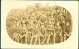 Group, WW1, soldiers resting on a bank. Wilfred B Quennell 3rd from left back row postcard stamped (front) - No known copyright restrictions