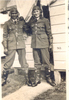 Group, 2 airmen, Levin 1941, Mervyn Jack Mills (NZ414321) and Alick Mewa (NZ414320) awhile at aircrew training in Levin in 1941, standing in front of Hut 98, wearing flying helmets, gloves and boots. - This image may be subject to copyright