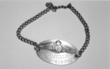 Identity tag, WW2, RNZAF, P.O. Mills NZ414321. - This image may be subject to copyright