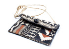 A rectangular shaped purse with the exterior made ...