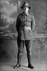 Full length portrait of Private George William Morrison, Reg No 12/4223, of the Auckland Infantry Battalion, - A Company, 11th Reinforcements. Died after discharge from the N.Z.E.F. from wounds inflicted or disease contracted while on active service, on 20 November 1918. (Photographer: Herman Schmidt, 1916). Sir George Grey Special Collections, Auckland Libraries, 31-M847. No known copyright.