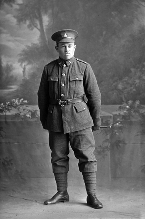 Full length portrait of Sapper Robert Adolphus Port, Reg No 37480, of the New Zealand Engineers Tunnelling Company, 3rd Reinforcements. (Photographer: Herman Schmidt, 1916). Sir George Grey Special Collections, Auckland Libraries, 31-P2426. No known copyright.