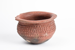 Earthenware bowl with lip. Has a rounded base and ...