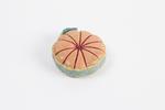 Leather pincushion description: small circular lea...