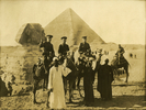 Photo of three soldiers on camels in front of the Sphinx and pyramids at Gaza, Egypt, 7 March 1915. l-r JDK (Kay) Strang (s/n 9/781), D McPhee (s/n 10/37), PG Tattle (s/n 10/246). Image kindly provided by Leanne Tattle. Image has no known copyright restrictions.