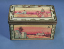 tin container used to carry hair pieces and eye gl...