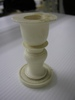 candlesticks: two (2) ivory candlesticks