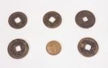 six bronze coins
