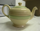 teapot, pale yellow glazed, green and gold banded,...